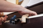 Perfect Perch hand support device for piano students with dyspraxia [Photo credit: http://www.outoftheshadowsphotography.com ]